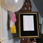 Large round balloon with tassels