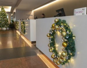 Christmas Wreaths hanging along reception desks