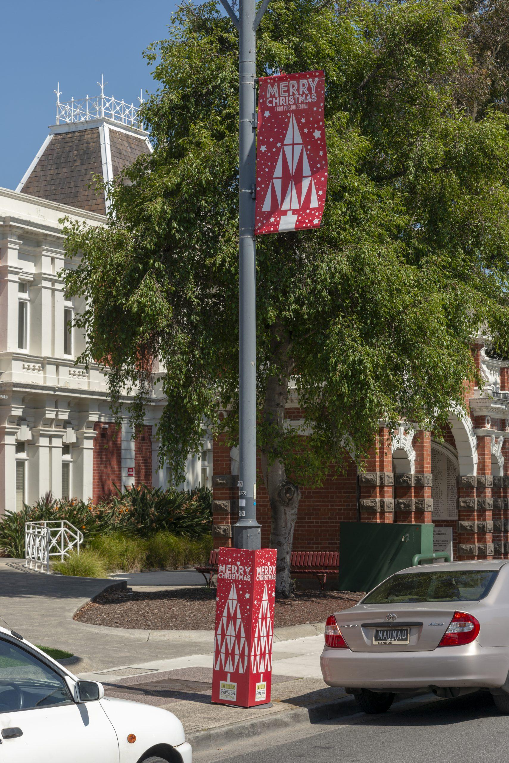 Street pole with Christmas wrap