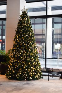 Large 15 foot Christmas tree decorated in gold and black