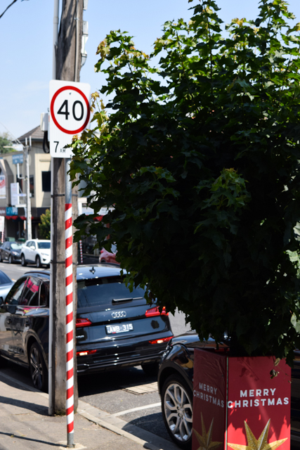 Street pole wrapped in candy stripe