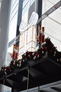 Nutcracker and giftbox on top of revolving doors