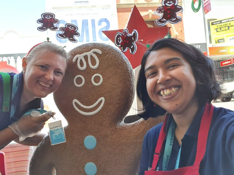 Gingerbread man and staff members