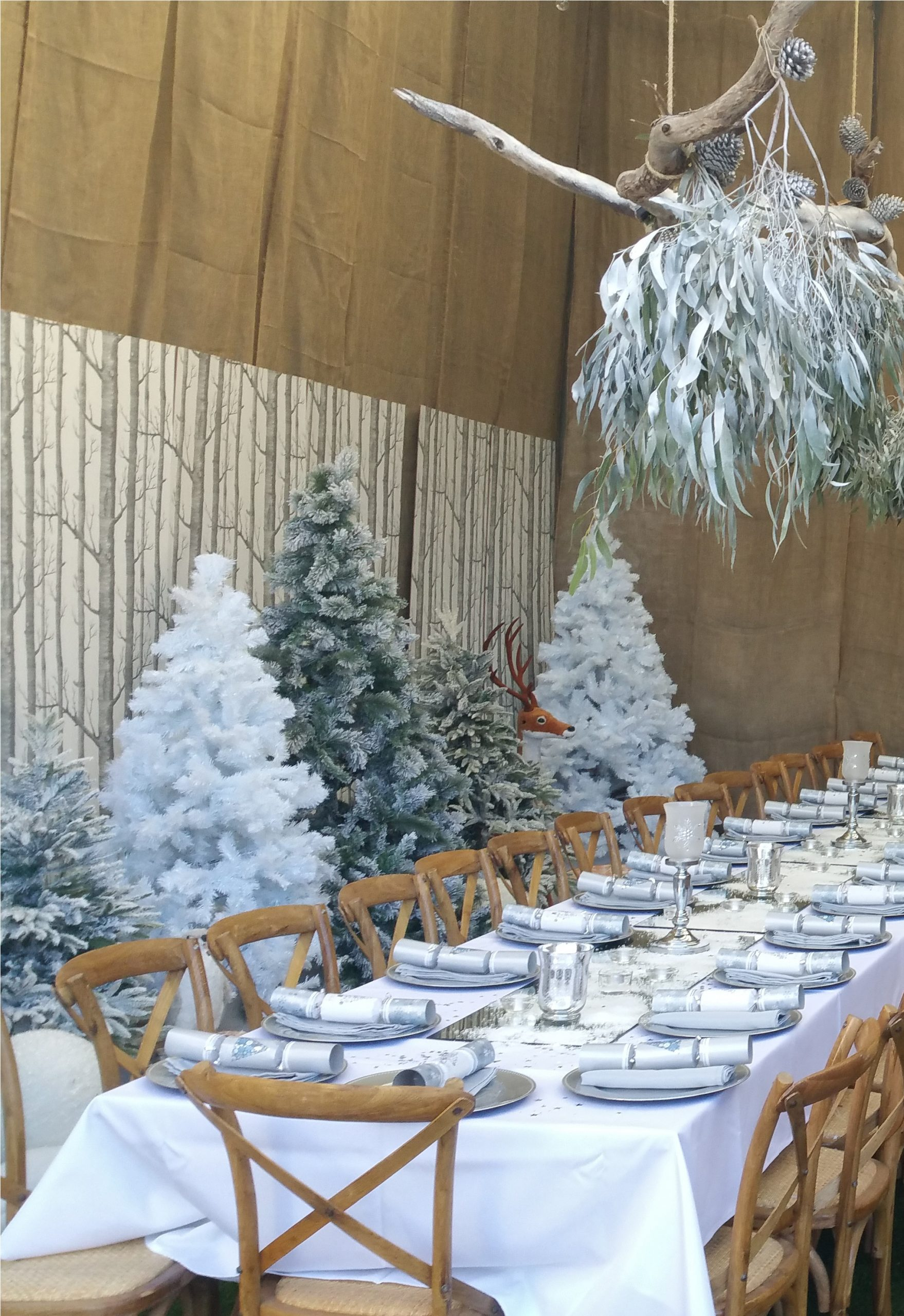 White dressed table with snowy decorations