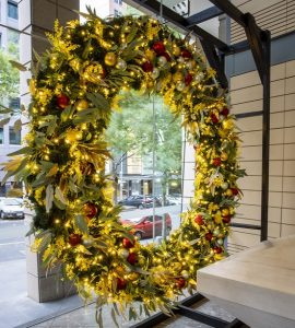 Large Christmas wreath in window with lights
