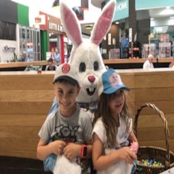 Easter Bunny in costume hugging customers