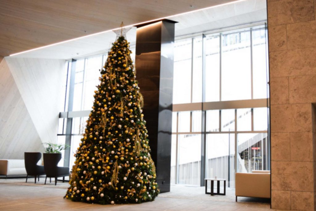 Large Christms tree in gold decorations.