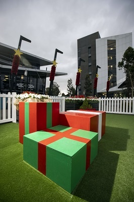 Wooden box garden seating painted in red and green