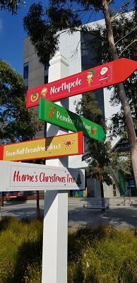 Christmas wayfinder sign in bright colours