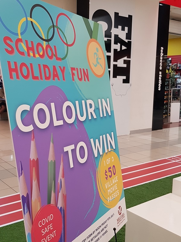 Colouring-in competition poster on easel