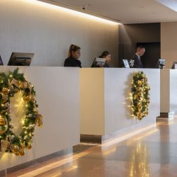 Christmas wreaths hanging reception desk Crown Plaza Hotel