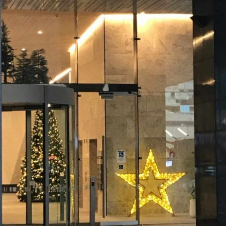 A 15 foot Artificial Christmas tree decorated in Spirit theme (gold and silver) together with our 2m golden LED star